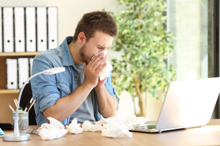 man indoors with fall allergies